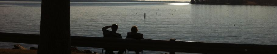 A couple watches the sunset at Lake Murray
