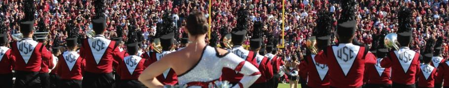 The marching band prepares to perform at a USC football game