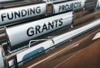 File folders with Grants and Funding labels